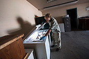 Kevin Woizeschke, Nongame Wildlife Specialist for the Minnesota Department of Natural Resources, digs through a storage freezer containing an assortment of found, deceased wildlife, including a bald eagle that had been hit by a vehicle, to find the unhatched loon egg collected from Eagle Lake at the DNR office in Brainerd August 29, 2017.