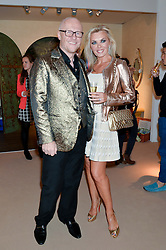 JOHN & LADY CAUDWELL at the Masterpiece Marie Curie Party supported by Jeager-LeCoultre held at the South Grounds of The Royal Hospital Chelsea, London on 30th June 2014.