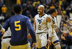 Feb 26, 2018; Morgantown, WV, USA; West Virginia Mountaineers guard Jevon Carter (2) celebrates after a timeout during the first half against the Texas Tech Red Raiders at WVU Coliseum. Mandatory Credit: Ben Queen-USA TODAY Sports
