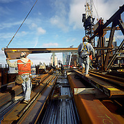 Workers moving steel. New York City.