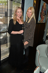 Left to right, KATIE MARSHALL and SITA KOLOSSA at the 'Ladies of Influence Lunch' held at Marcus, The Berkeley Hotel, London on 12th May 2014.