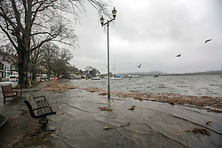 © Licensed to London News Pictures. 15/11/2015. Windermere UK. Picture shows benches slowly being covered with water on the shore of Lake Windermere after last nights heavy rainfall, more rain is expected & the Environment agency have issued alerts for the area. Photo credit: Andrew McCaren/LNP