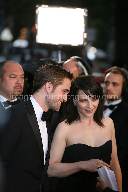 Robert Pattinson, Juliette Binoche at the Cosmopolis gala screening at the 65th Cannes Film Festival France. Cosmopolis is directed by David Cronenberg and based on the book by writer Don Dellilo.  Friday 25th May 2012 in Cannes Film Festival, France.