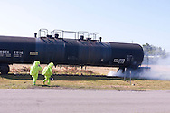 New Hampton, New York - The Orange County Hazardous Materials (HAZMAT) Response Team works during a drill where they practiced responding to a tanker railcar leaking chlorine gas at the Orange County Fire Training Center in New Hampton, New York, on Aug. 9, 2014. The smoke is from a smoke machine.
