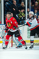 KELOWNA, BC - FEBRUARY 7: Jake Lee #21 of the Kelowna Rockets stick checks Jake Gricius #14 of the Portland Winterhawks during second period at Prospera Place on February 7, 2020 in Kelowna, Canada. (Photo by Marissa Baecker/Shoot the Breeze)