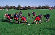 A5EXPC Team coach doing warm up exercises with boys football team