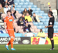Blackpool's John Lundstram is shown a yellow card by Referee Darren Bond<br /> <br /> Photographer Rich Linley/CameraSport<br /> <br /> Football - The Football League Sky Bet Championship - Huddersfield Town v Blackpool  - Saturday 18th October 2014 - The John Smith's Stadium - Huddersfield<br /> <br /> © CameraSport - 43 Linden Ave. Countesthorpe. Leicester. England. LE8 5PG - Tel: +44 (0) 116 277 4147 - admin@camerasport.com - www.camerasport.com
