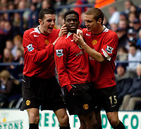 Photo: Jed Wee.<br />Bolton Wanderers v Manchester United. The Barclays Premiership. 01/04/2006.<br />Manchester United's John O'Shea (L) and Nemanja Vidic (R) celebrate with goalscorer Louis Saha.