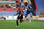 Wigan Athletic's Jean Beausejour (r) gets the ball ahead of Queens Park Rangers Danny Simpson. Skybet football league championship play off semi final, 1st leg match, Wigan Athletic v QPR at the DW Stadium in Wigan, England on Friday 9th May 2014.<br /> pic by Chris Stading, Andrew Orchard sports photography.