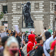 Protesters gather near the statue to former British PM Winston Churchill during a demonstration in Parliament Square in London on Wednesday, June 3, 2020, over the death of George Floyd, a black man who died after being restrained by Minneapolis police officers on May 25. Protests have taken place across America and internationally after a white Minneapolis police officer pressed his knee against Floyd's neck while the handcuffed black man called out that he couldn't breathe. The officer, Derek Chauvin, has been fired and charged with murder. (Photo/ Vudi Xhymshiti)