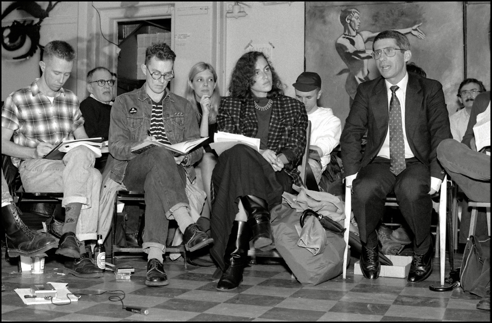 On October 19, 1989 ACT UP NY hosted an historic three hour meeting with Anthony Fauci, the then Director of the National Institute of Allergy and Infectious Diseases (NIAID), at The Gay and Lesbian Community Center (The Center) in New York City. The audience was allowed to ask Fauci questions related to HIV disease progression, treatment, community-based drug trials and allegations of homophobia in relation to Community Research Initiative funding. <br /> <br /> Front row (L-R): Mark Harrington, Simon Watney, Peggy Hamburg, Anthony Fauci and Richard Elovich (cut off)<br /> <br /> Back row (L-R):  Larry Kramer, Dr. Suzanne Phillips, Keith Alcorn, Steve Rosenbush