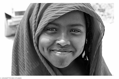 Smiling young girl shows her dimples Asaita Refugee Camp, Afar, Ethiopia 2016