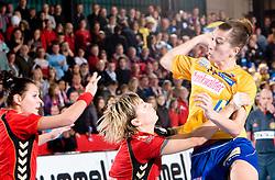 Marina Vergeljuk of Krim vs Marion Limal of Hypo at handball match of Round 3 of Champions League between RK Krim Mercator and Hypo Niederosterreich, on November 8, 2009, in Arena Kodeljevo, Ljubljana, Slovenia.  Krim won 35:24. (Photo by Vid Ponikvar / Sportida)