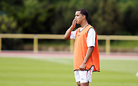 Photo: Chris Ratcliffe.<br />England training session. 06/06/2006.<br />Theo Walcott keeps his thoughts to himself in England's first training session.