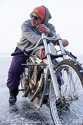 Russian customizer Dima (Dmitry Golubchikov) of Zillers Garage with his full custom, all aluminum, methanol fueled land speed racer (LSR) powered by two Jawa 500cc engines. It was raced at the Baikal Mile Ice Speed Festival. Maksimiha, Siberia, Russia. Saturday, February 29, 2020. Photography ©2020 Michael Lichter.