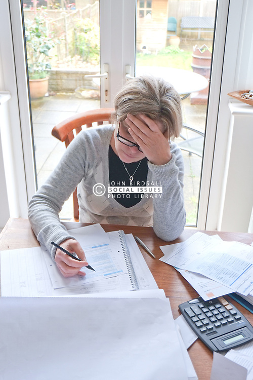 Working from home, small business accounts, worry over household finances. Model released