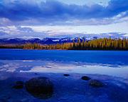 Spring break-up of ice at Boya Lake with the Horseranch Range beyond, Boya Lake Provincial Park, Dease Plateau, British Columbia, Canada.