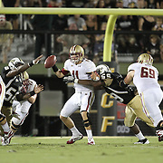 Boston College quarterback Chase Rettig (11) gets sacked by Central Florida defensive end LeBranden Richardson (59) passes the ball during an NCAA football game between the Boston College Eagles and the UCF Knights at Bright House Networks Stadium on Saturday, September 10, 2011 in Orlando, Florida. (AP Photo/Alex Menendez)
