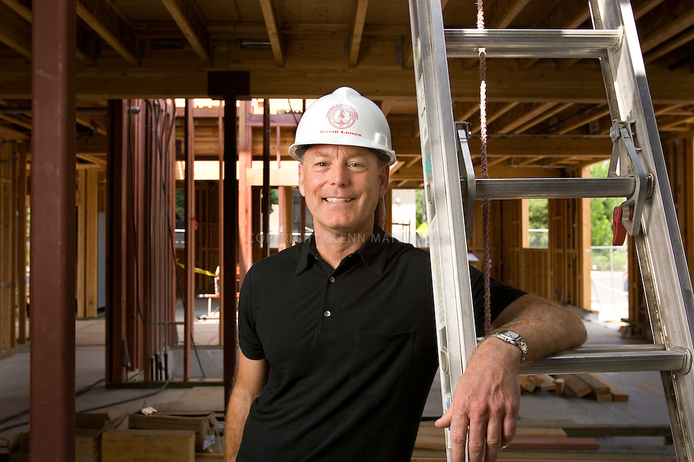 David Lenox, Stanford University architect at construction site of new Stanford Daily building.