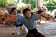 Two boy pupils at traditional Balinese dance school. Sanur, Bali, Indonesia