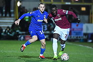 Wimbledon defender Dylan Connolly(16) and West Ham United defender Arthur Masuaku (26) battle for the ball during the The FA Cup fourth round match between AFC Wimbledon and West Ham United at the Cherry Red Records Stadium, Kingston, England on 26 January 2019.