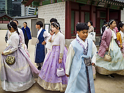 October 10, 2018 - Seoul, Gyeonggi, South Korea - South Korean students wear ''Hanbok'' style clothing at Gyeongbokgung Palace in Seoul. Hanbok is traditional Korean clothing, originally popular in the late Joseon dynasty, before the Japanese conquest of Korea. It is known for vibrant colors and simple lines without pockets. The term literally means ''Korean clothing'', but hanbok usually refers specifically to clothing of the Joseon period. The South Korean government encourages people to wear Hanbok clothing to festivals and cultural celebrations and some museums give free admiccion to people wearing Hanbok clothing. (Credit Image: © Jack Kurtz/ZUMA Wire)