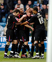 Photo: Daniel Hambury.<br />Millwall FC v Crystal Palace. Coca Cola Championship. 18/02/2006.<br />Palace's Ben Watson (facing) is mobbed by team mates after scoring the fdirst goal.