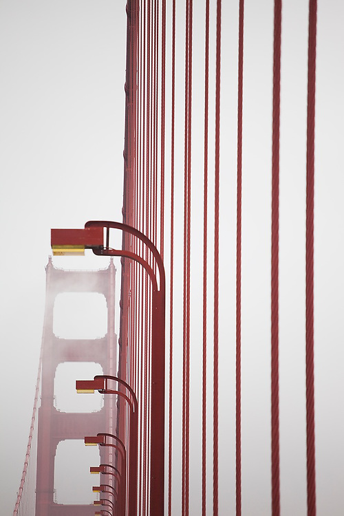 Detail of the Golden Gate Bridge structure on a foggy day in San Francisco, California.