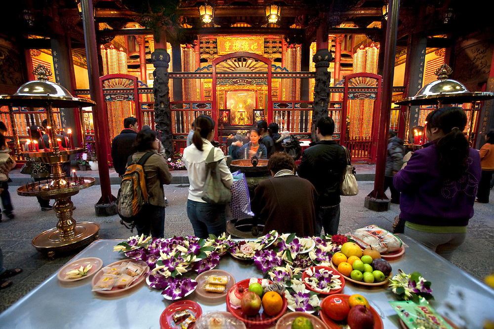 The Longshan Temple in downtown Taipei, although officially Buddhist and dedicated to the Goddess of Mercy, has traces of many other folk religions. (From the book What I Eat: Around the World in 80 Diets.)