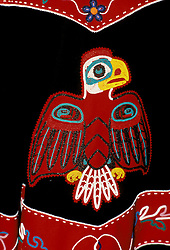 AK: Alaska Tlingit Indian clothing, eagle motif       .Photo Copyright: Lee Foster, lee@fostertravel.com, www.fostertravel.com, (510) 549-2202.Image: aksitk211.