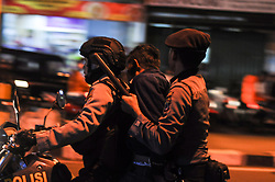 May 10, 2017 - A provocateur who disrupted the peaceful action to give support to Jakarta Governor Basuki Cahaya Purnama (Ahok) for criminal blasphemy, in Yogyakarta, Indonesia, was secured by police on Thursday, May 10, 2017. On Wednesday, May 9, 2017, Judges handed down the verdict Two years for the minority Christian governor on Tuesday for blaspheming the Quran, a jarring ruling that undermines the reputation of the world's largest Muslim nation for practicing a moderate form of Islam. (Credit Image: © Slamet Riyadi via ZUMA Wire)