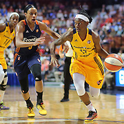 UNCASVILLE, CONNECTICUT- JUNE 5:   Erica Wheeler #17 of the Indiana Fever drives to the basket past Jasmine Thomas #5 of the Connecticut Sun during the Indiana Fever Vs Connecticut Sun, WNBA regular season game at Mohegan Sun Arena on June 3, 2016 in Uncasville, Connecticut. (Photo by Tim Clayton/Corbis via Getty Images)