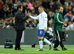 06.09.2011, Wembley Stadium, London, GBR, UEFA EURO 2012, Qualifikation, England vs Wales, im Bild England's Wayne Rooney shakes hands with manager Fabio Capello after being substituted during the UEFA Euro 2012 Qualifying Group G match at Wembley Stadium on 6/9/2011. EXPA Pictures © 2011, PhotoCredit: EXPA/ Propaganda Photo/ Chris Brunskill +++++ ATTENTION - OUT OF ENGLAND/GBR+++++