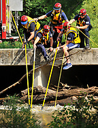 The San Antonio Fire Departments' Technical Rescue Team secures a car that was swept away in the high water of Leon Creek near Cassin Rd. and I35 Monday afternoon. The unidentified female driver drowned.