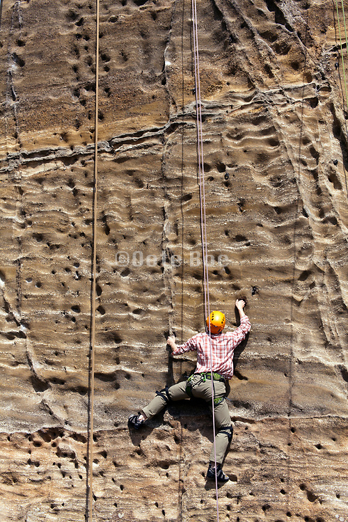 climbing of a vertical rock mountain wall Takatoriyama park Yokosuka Japan
