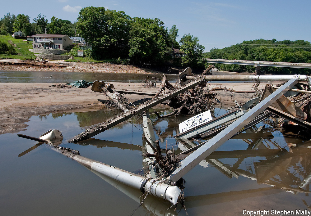A boat ramp lays crumpled on the ground along Delhi Lake in Delhi, Iowa on Monday, July 26, 2010.