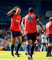 Photo. Jed Wee, Digitalsport<br /> Lucas Radebe Testimonial, Leeds United XI v International XI, 02/05/2005.<br /> John Carew (L) congratulates Lucas Radebe on his goal.