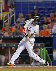 August 16, 2017 - Miami, FL, USA - The Miami Marlins' Derek Dietrich reaches on a fielding error by San Francisco shortstop Brandon Crawford during the first inning at Marlins Park in Miami on Wednesday, Aug. 16, 2017. The Marlins won, 8-1. (Credit Image: © David Santiago/TNS via ZUMA Wire)