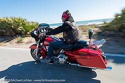 Fabrizio Panzarino of Italy out for a ride on his rented Harley-Davidson dresser during Daytona Bike Week. FL, USA. March 14, 2014.  Photography ©2014 Michael Lichter.