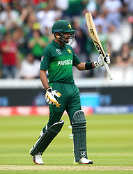 Pakistan's Babar Azam celebrates reaching his half century during the ICC Cricket World Cup group stage match at Lord's, London.