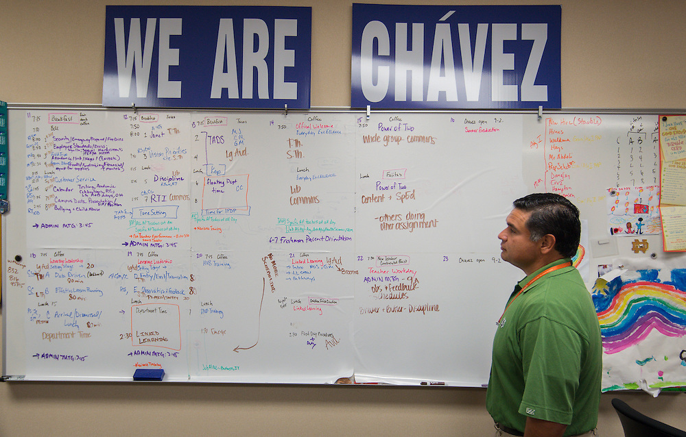 Principal Rene Sanchez looks over plans for the first day of school at Chavez High School, August 20, 2014.