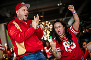 SAN FRANCISCO, CA - FEBRUARY 02: Paul Ostergar (L) and his wife Priscilla Ostergar of West Sacramento, California react as they watch the San Francisco 49ers play the Kansas City Chiefs during a Super Bowl LIV watch party at SPIN San Francisco on February 2, 2020 in San Francisco, California. The San Francisco 49ers face the Kansas City Chiefs in Super Bowl LIV for their seventh appearance at the NFL championship, and a potential sixth Super Bowl victory to tie the New England Patriots and Pittsburgh Steelers for the most wins in NFL history. (Photo by Philip Pacheco/Getty Images)