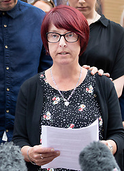 © Licensed to London News Pictures. 18/07/2018. Woking, UK. Private Sean Benton's sister Tracy Lewis reads a statement as she and other family members leave Woking Coroner's Court after hearing the coroner's verdict that Sean died of self inflicted gunshot wounds to the chest. Pte Sean Benton was found with five gunshot wounds to his chest at Deepcut army base in 1995. Photo credit: Peter Macdiarmid/LNP
