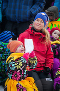 A girl holds a sheet of song lyrics at SolFest in Longyearbyen, Svalbard. The festival marks the official arrival of the sun to the town – by tradition, to the old hospital steps (sykehustrappa).