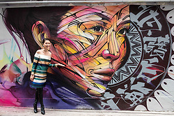 November 10, 2016 - Hong Kong, Hong Kong S.A.R, China - Wall painting by Parisian street artist Alexandre Monteiro aka Hopare of Hong Kong actress and canto pop star Niki Chow (pictured).''Walls of Change'' street art in Hong Kong ahead of the The √íHope for Wildlife√ì Gala Dinner painted to raise awareness for the plight of endangered animals the world over..Sai Yin Pun Hong Kong.10th November 2016. Photo by Jayne Russell (Credit Image: © Jayne Russell via ZUMA Wire)