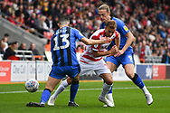 Herbie Kane of Doncaster Rovers (15) takes on Callum Reilly of Gillingham (13) and Tom Eaves of Gillingham (9) during the EFL Sky Bet League 1 match between Doncaster Rovers and Gillingham at the Keepmoat Stadium, Doncaster, England on 20 October 2018.