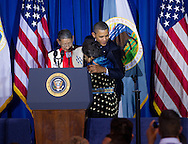 U.S. President Barack Obama (R) thanks Sonny (L) and Mary Black Eagle (C), his 'adoptive parents' from the Crow Tribe during the 2011 White House Tribal Nations Conference  which he hosted at the Department of the Interior in Washington, DC on December 2nd, 2011.
