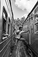 A passenger changes trains at a station stop somewhere between Colombo and Kandy, Sri Lanka.<br /><br />(April 1, 2017)