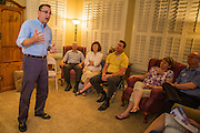 """03 AUGUST 2012 - GILBERT, AZ:  MATT SALMON talks to Republican voters during a campaign """"meet & greet"""" in Gilbert, AZ, Friday night. Salmon is running in the Republican primary for Arizona's 5th Congressional District. Salmon previously served in Congress from 1994 until 2000. CD5 is a primarily Republican district, with a large number of conservative Mormons, in the suburbs east of Phoenix. Salmon is running against Kirk Adams, a former Speaker of the Arizona House of Representatives. Whoever wins the August 28 Republican primary will probably win in November's general election.  PHOTO BY JACK KURTZ"""