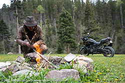 Danger Dan Hardick at a campfire with his 2-week old Harley-Davidson Pan-America adventure bike on a trail just outside Red River, NM, USA. Saturday, May 29, 2021. Photography ©2021 Michael Lichter.
